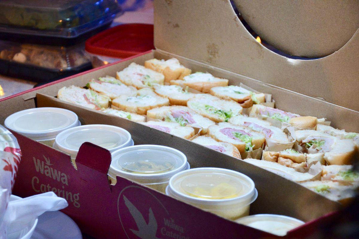 a catering box of wawa hoagies