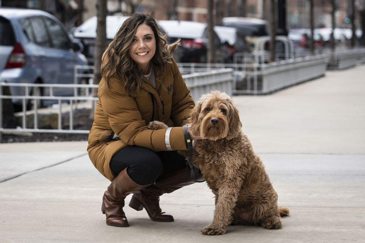 Shannon Failla, 31, with her labradoodle Kingston near her South Loop apartment building.