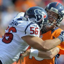 Denver Broncos quarterback Peyton Manning (18) is hit by Houston Texans inside linebacker Brian Cushing (56) in the second quarter of an NFL football game Sunday, Sept. 23, 2012, in Denver.