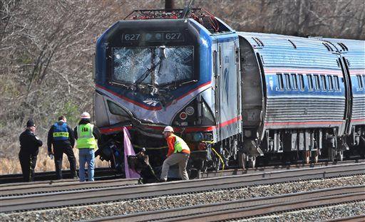 Amtrak investigators inspect the deadly train crash in Chester, Pennsylvania on Sunday, April 3, 2016. The Amtrak train struck a backhoe just south of Philadelphia, causing a derailment.   Michael Bryant/The Philadelphia Inquirer via AP