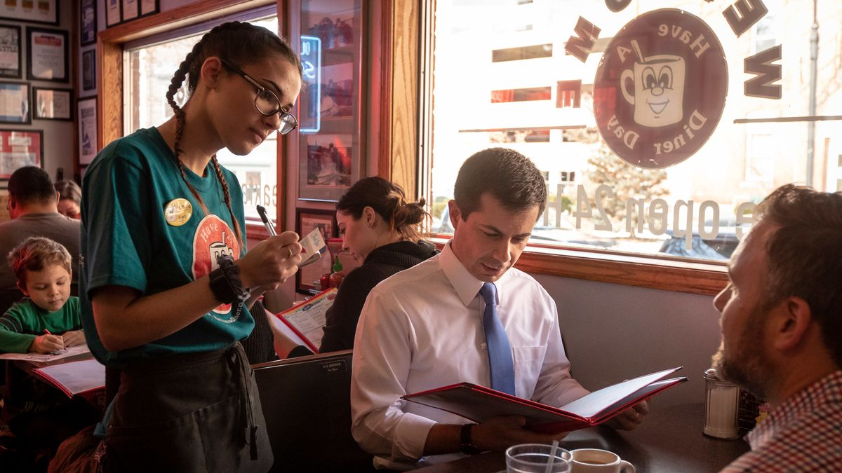 Pete Buttigieg sitting by a window at the Red Arrow Diner
