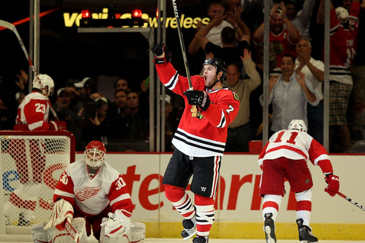 Brent Seabrook puts one be- hey, Is that Chris Osgood?