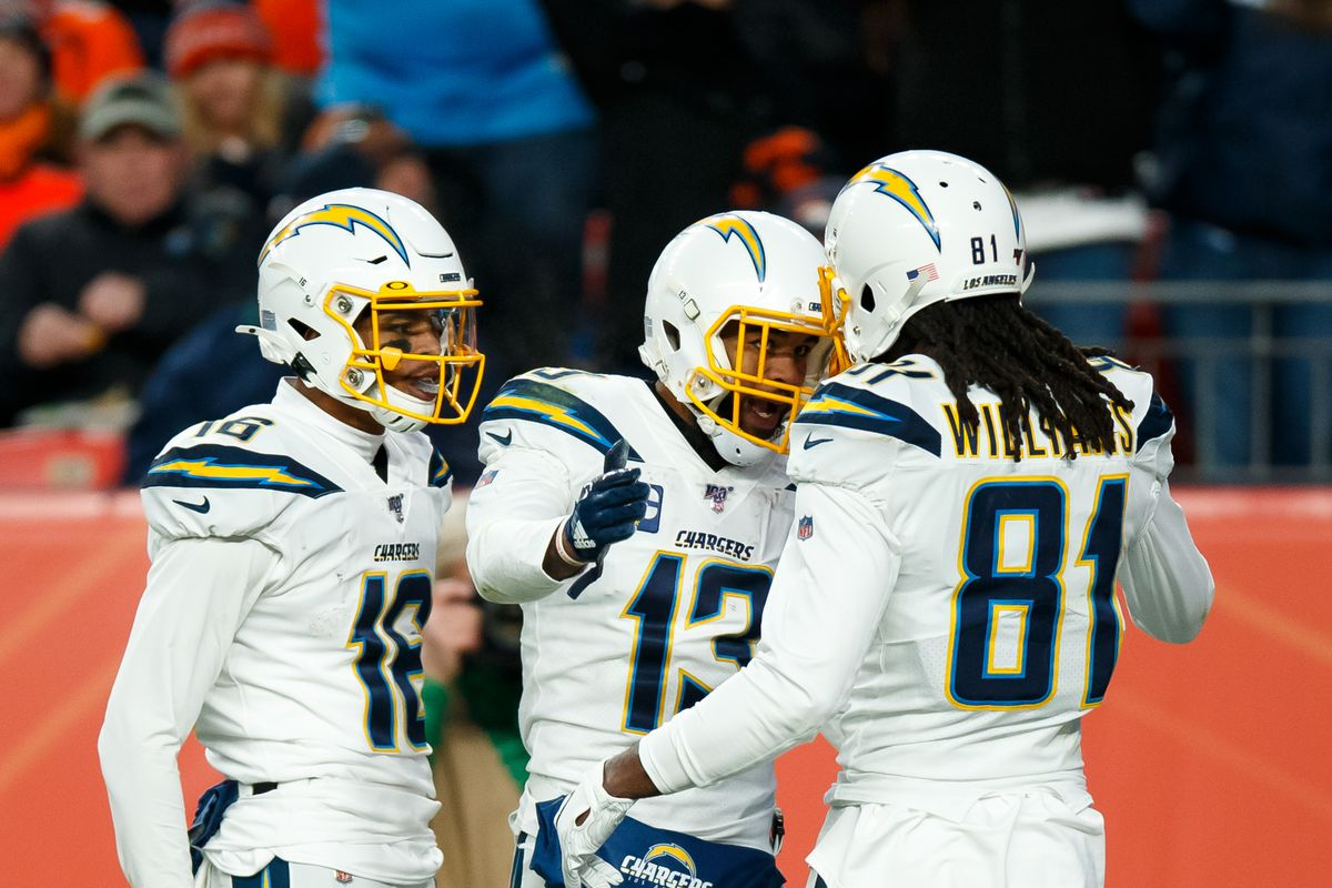 Keenan Allen #13 of the Los Angeles Chargers celebrates his fourth quarter touchdown with wide receiver Andre Patton #16 and wide receiver Mike Williams #81 against the Denver Broncos at Empower Field at Mile High on December 1, 2019 in Denver, Colorado.