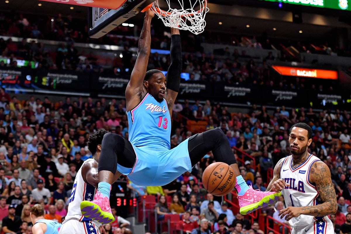 Miami Heat center Bam Adebayo dunks the ball past Philadelphia 76ers center Joel Embiid during the first half at American Airlines Arena.