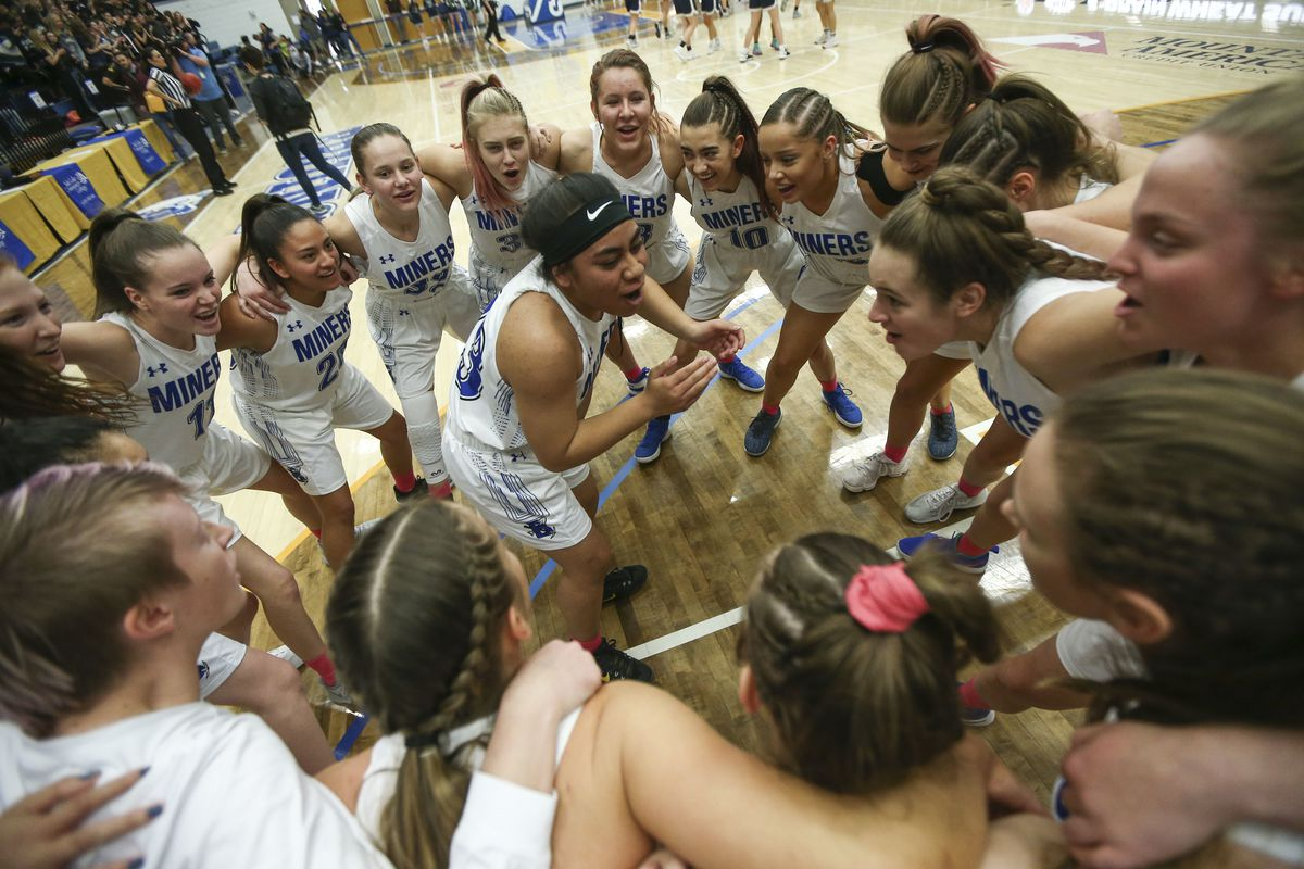 The Bingham Miners circle and cheer before playing the Copper Hills Grizzlies during the 6A girls basketball championship at the Lifetime Activities Center in Taylorsville on Saturday, Feb. 23, 2019.