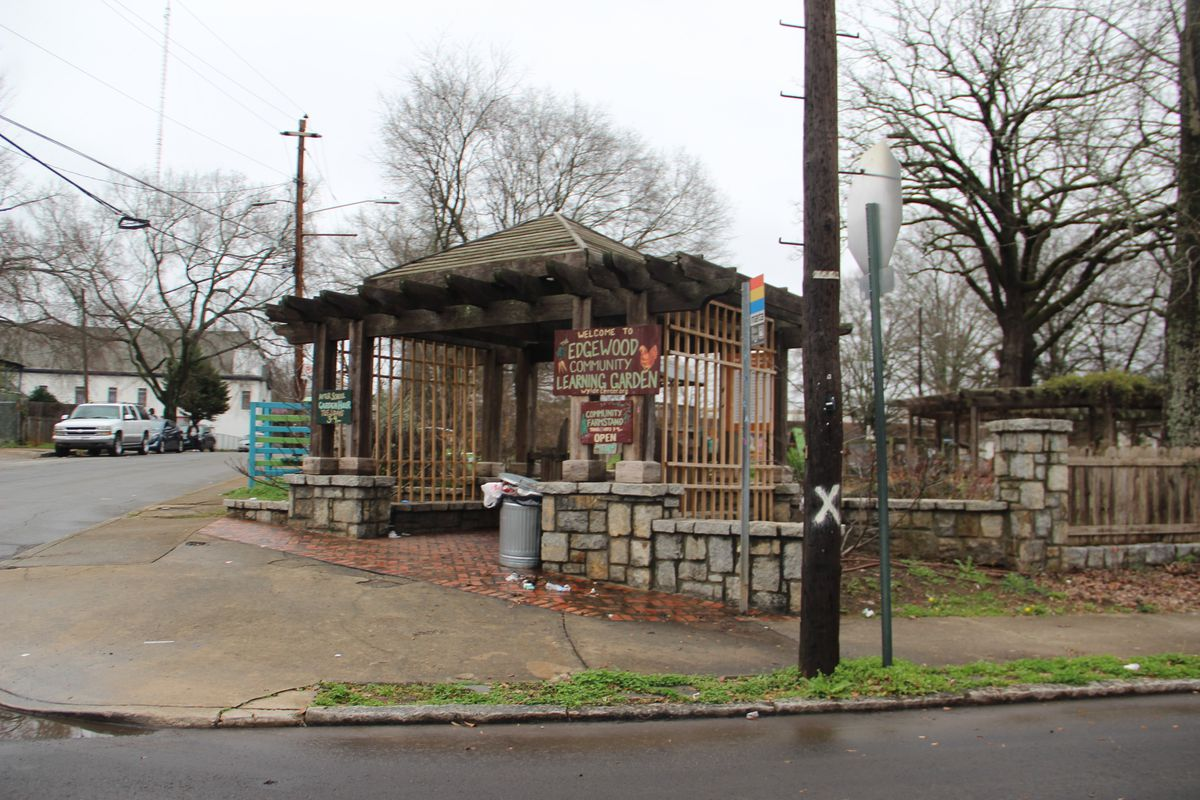 A community garden with stone gates.