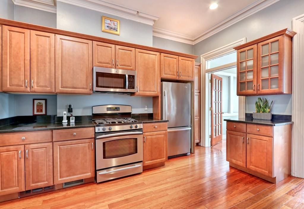 A kitchen with a run of cabinets above a counter.