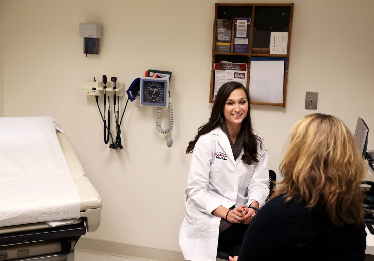 Nutritionist/dietitian Courtney Schuchmann confers with a patient in her office.
