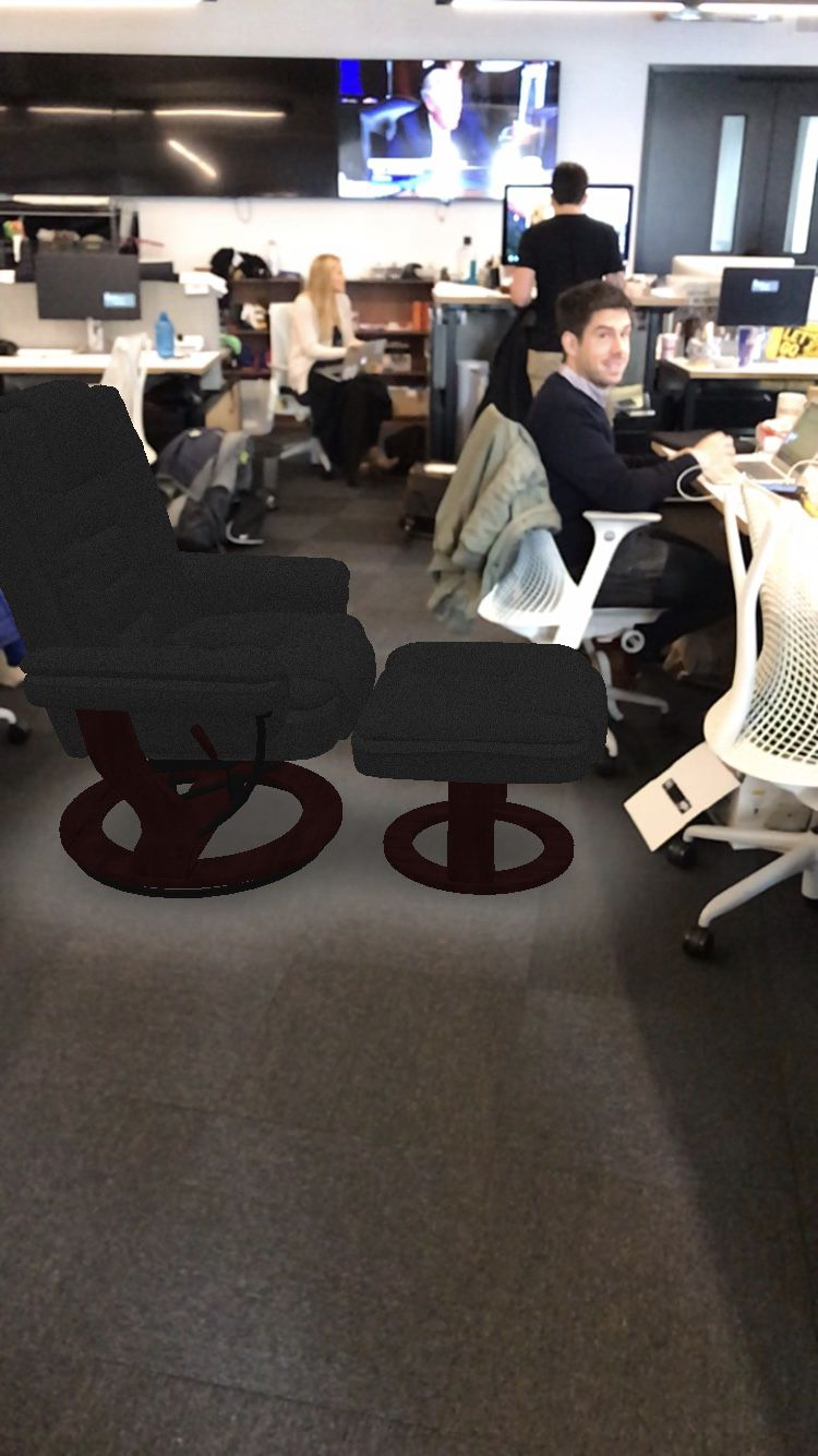 A chair sold on Amazon being viewed through the company's new augmented reality feature
