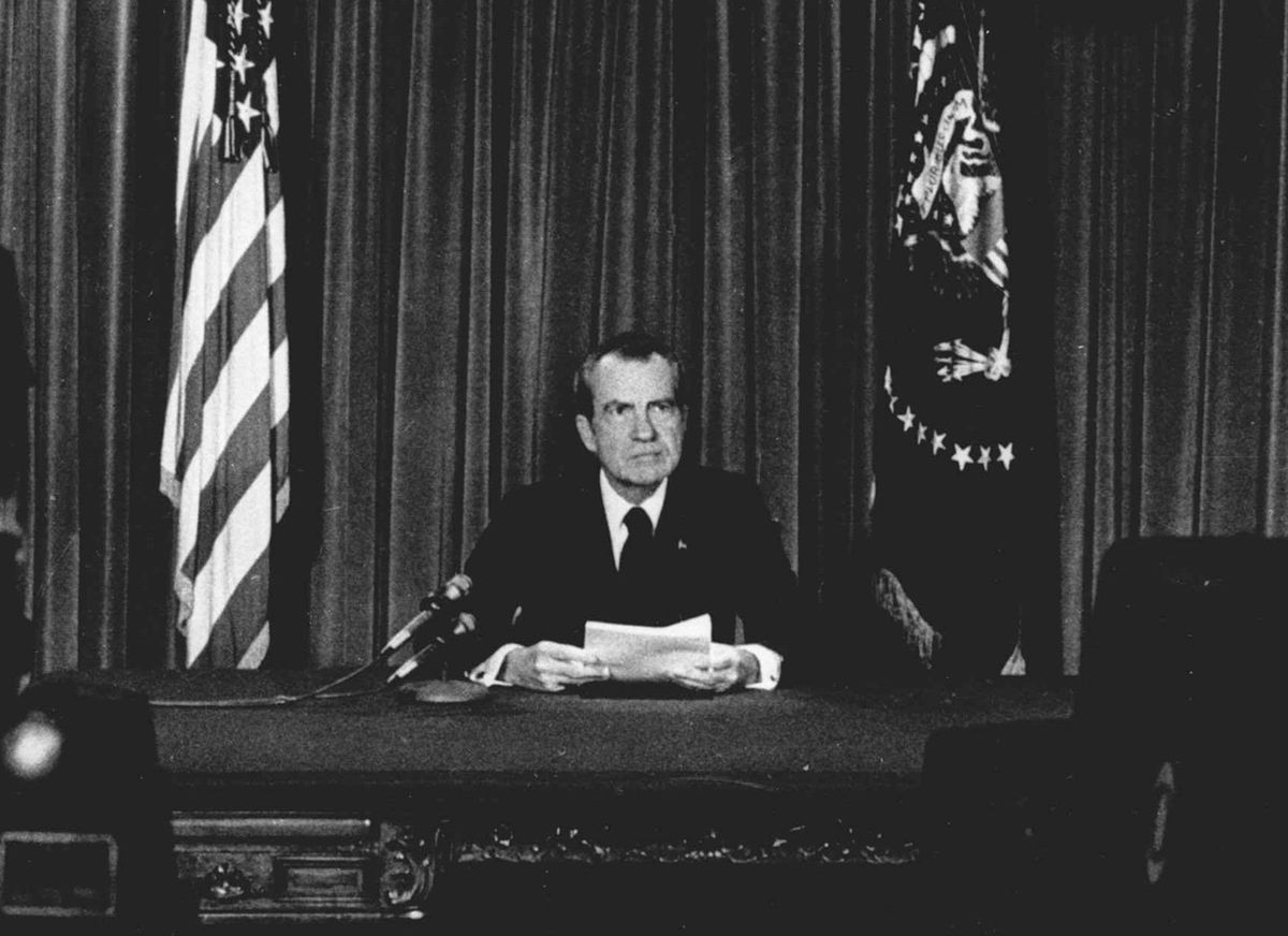 President Richard Nixon is shown on Aug. 8, 1974, speaking from the Oval Office to announce that he would resign from office effective at noon the next day.
