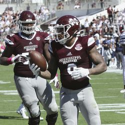 Mississippi State wide receiver Donald Gray (6) reacts after for a touchdown catch during the first half of an NCAA college football game against BYU in Starkville, Miss., Saturday, Oct. 14, 2017. (AP Photo/Jim Lytle)