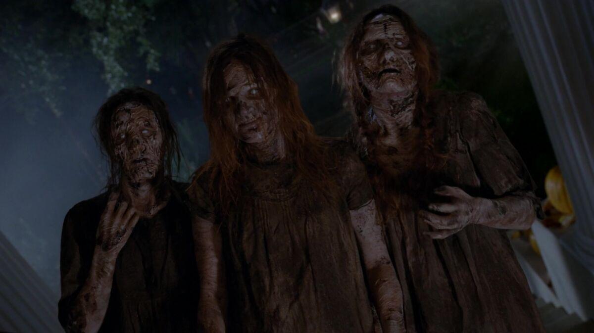 three rotting zombies