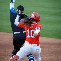 BYU infielder Olivia Sanchez (24) grabs the ball just before Utah's Julia Noskin (10) touches the bag to end the third inning as the University of Utah hosts Brigham Young University at Duke Stadium in Salt Lake City on Wednesday, April 18, 2018.