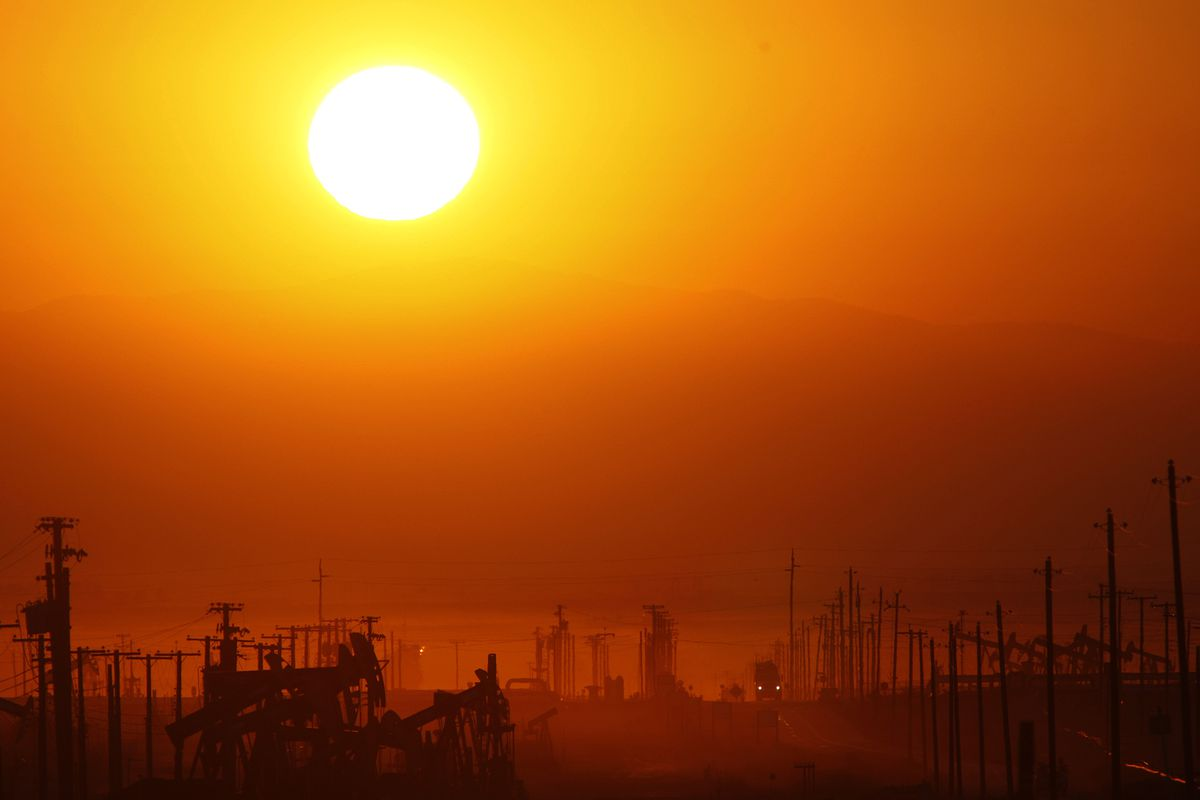 LOST HILLS, CA - MARCH 24: The sun rises over an oil field over the Monterey Shale formation where gas and oil extraction using hydraulic fracturing, or fracking, is on the verge of a boom on March 24, 2014 near Lost Hills, California.