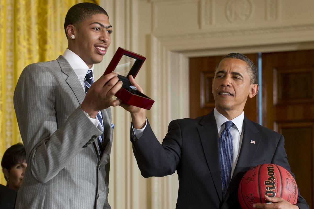 US President Barack Obama holds a champi