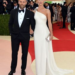 Jason Statham and Rosie Huntington-Whiteley, who is wearing a Ralph Lauren gown.