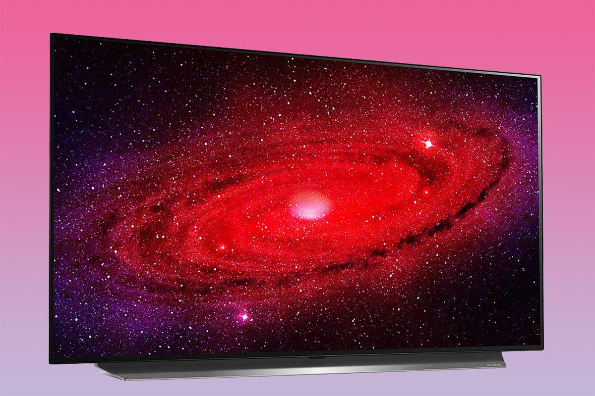 LG CX television on a pink gradient background, showing a red spiral galaxy