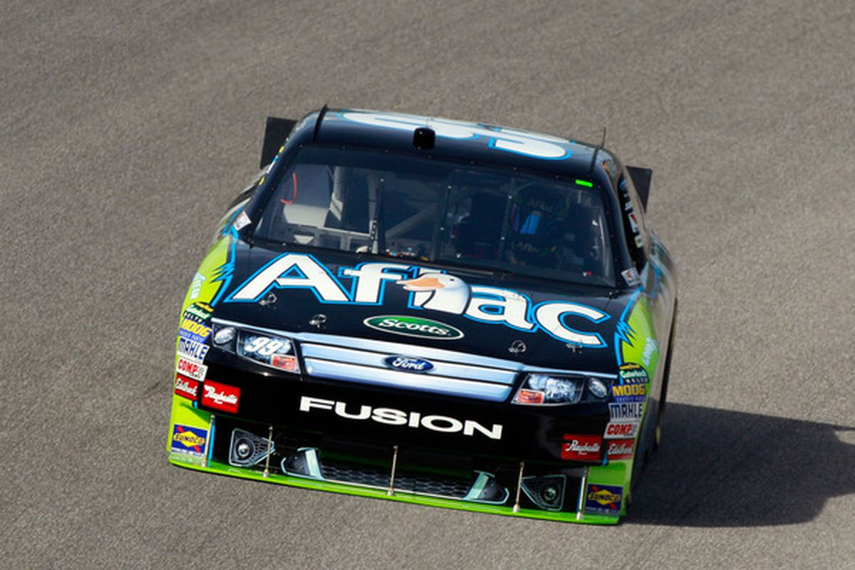 HOMESTEAD FL - NOVEMBER 19:  Carl Edwards driver of the #99 Aflac Ford practices for the NASCAR Sprint Cup Series Ford 400 at Homestead-Miami Speedway on November 19 2010 in Homestead Florida.  (Photo by Sam Greenwood/Getty Images for NASCAR)