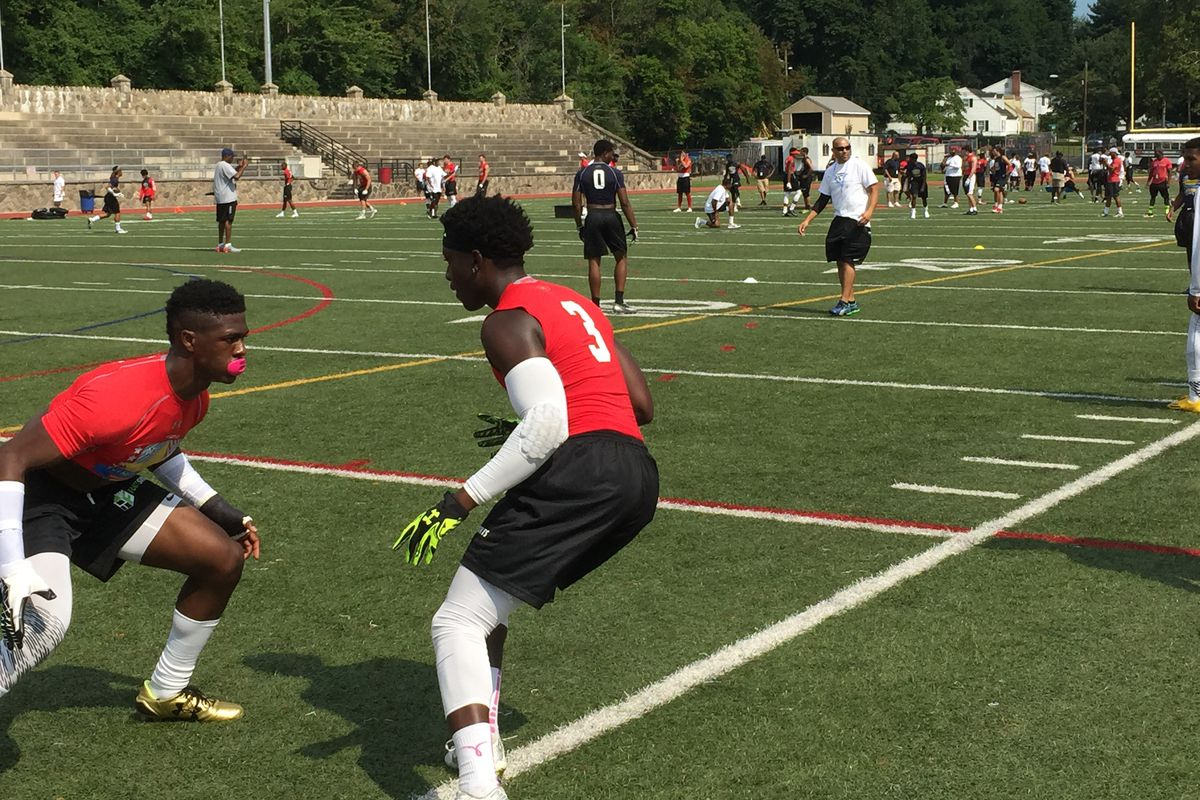 UConn 2016 commit Tahj Herring (right) matches up with C.J. Holmes, a 2017 target of the Huskies, during a drill at Stamford High School Saturday.