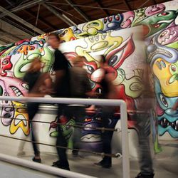 Inside MOCA's exhibition at the Geffen Contemporary, Art in the Streets. Image via the New York Times.