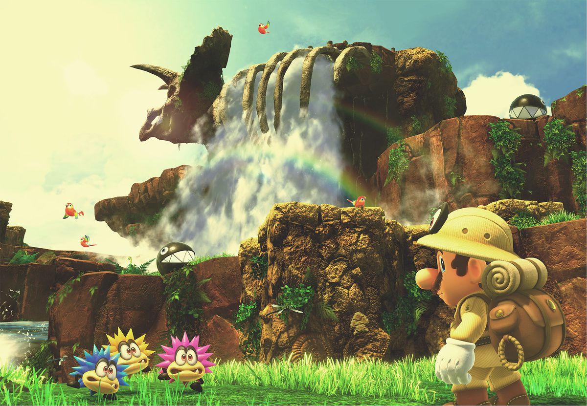 Super Mario Odyssey - Mario in nature explorer outfit standing in front of a waterfall