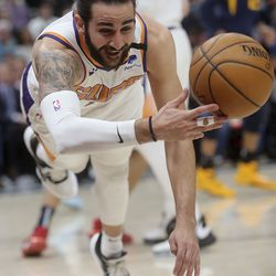 Phoenix Suns guard Ricky Rubio (11) dives for the ball during an NBA game against his old team, the Utah Jazz, at the Vivint Smart Home Arena in Salt Lake City on Monday, Feb. 24, 2020.
