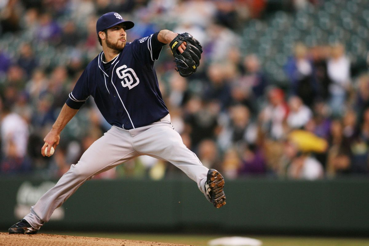 April 17, 2012; Denver, CO, USA; San Diego Padres pitcher Anthony Bass (45) delivers a pitch during the first inning against the Colorado Rockies at Coors Field. Mandatory Credit: Chris Humphreys-US PRESSWIRE