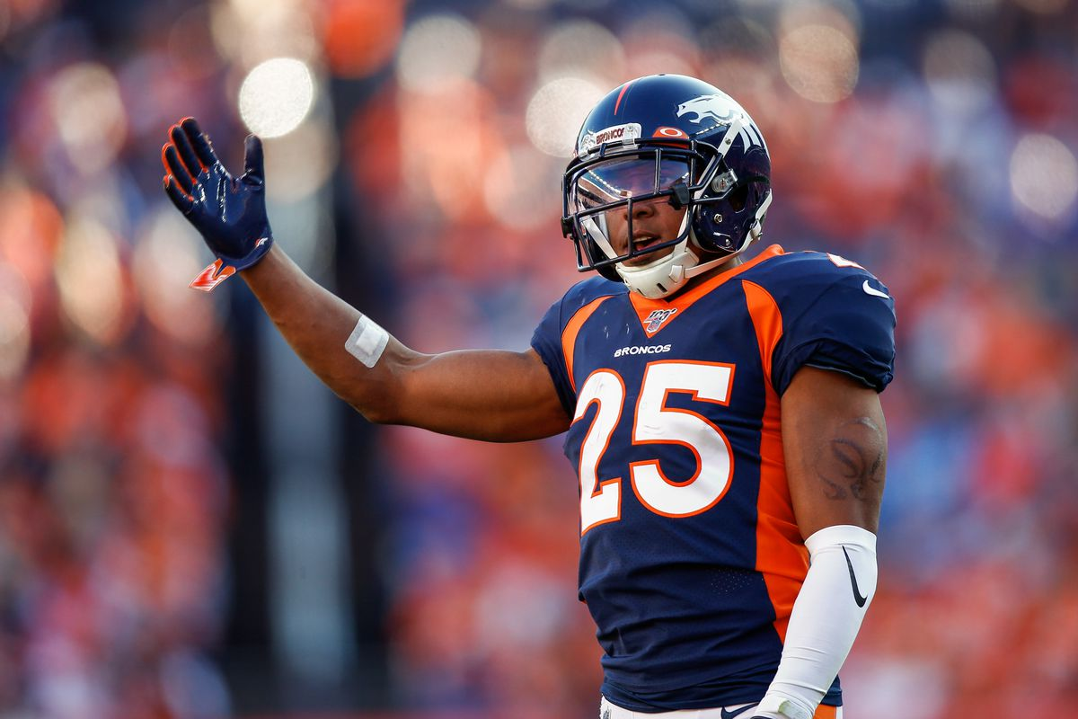 Denver Broncos cornerback Chris Harris Jr. motions in the third quarter against the Tennessee Titans at Empower Field at Mile High.