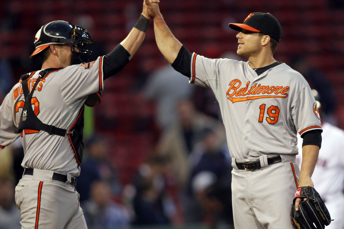 Baltimore Orioles first baseman Chris Davis celebrates with catcher Matt Wieters after defeating the Boston Red Sox 9-6 in 17th innings at Fenway Park. Mandatory Credit: Greg M. Cooper-US PRESSWIRE