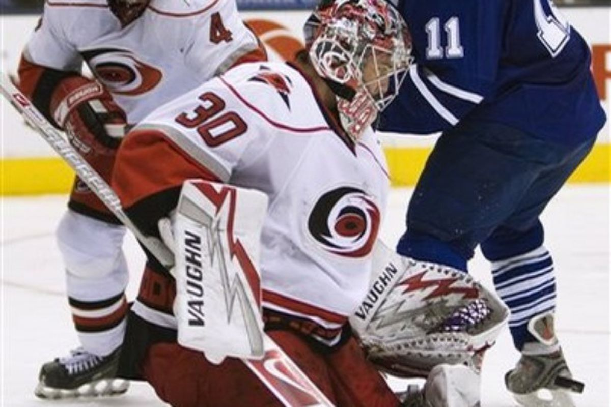 Jiri Tlusty is stopped by Carolina's Cam Ward, his new team mate.