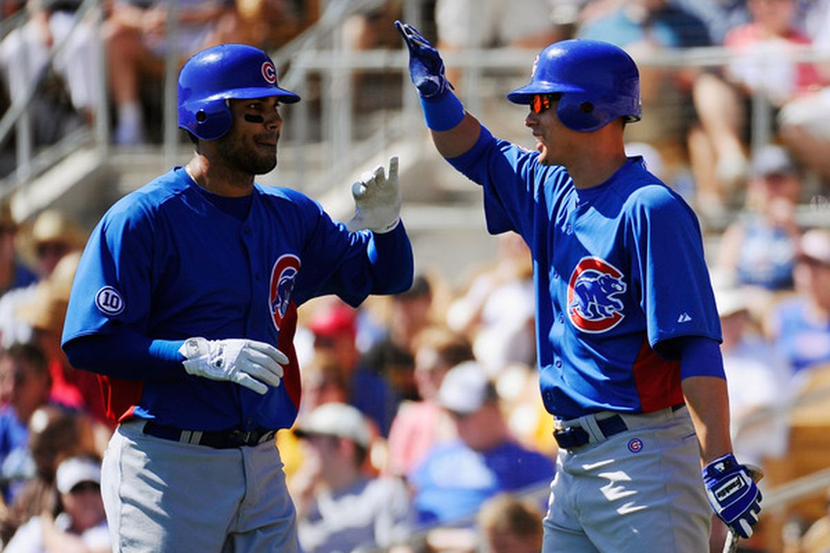 Carlos Pena of the Chicago Cubs is congratulated by Luis Montanez during the second inning of the spring training baseball game at Camelback Ranch in Glendale, Arizona.  (Photo by Kevork Djansezian/Getty Images)