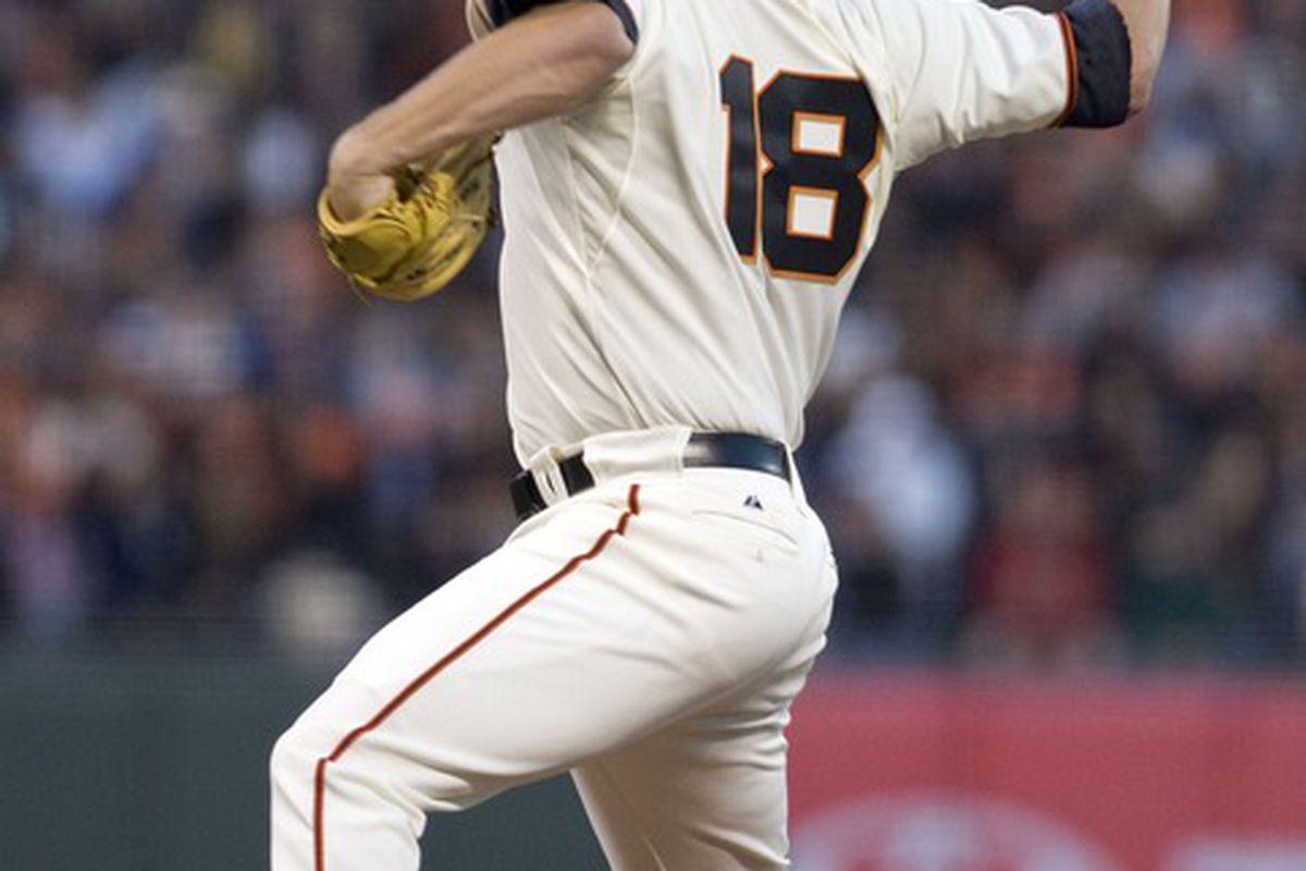 June 13, 2012; San Francisco, CA, USA; San Francisco Giants starting pitcher Matt Cain (18) throws a pitch during the game against the Houston Astros at AT&T Park.  Mandatory Credit: Ed Szczepanski-US PRESSWIRE