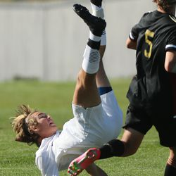 Wasatch's Aiden Rowser bicycle kicks during a game against Maple Mountain in Spanish Fork on Thursday, April 29, 2021.