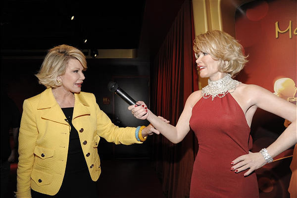 Comedian Joan Rivers touches a wax figure of herself while touring the new Madame Tussauds Hollywood in Los Angeles last week.