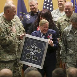 Utah Air National Guard Brig. Gen. Christine Burckle is made an honorary chief during her retirement ceremony at the Roland R. Wright Air National Guard Base in Salt Lake City on Thursday, Aug. 29, 2019.