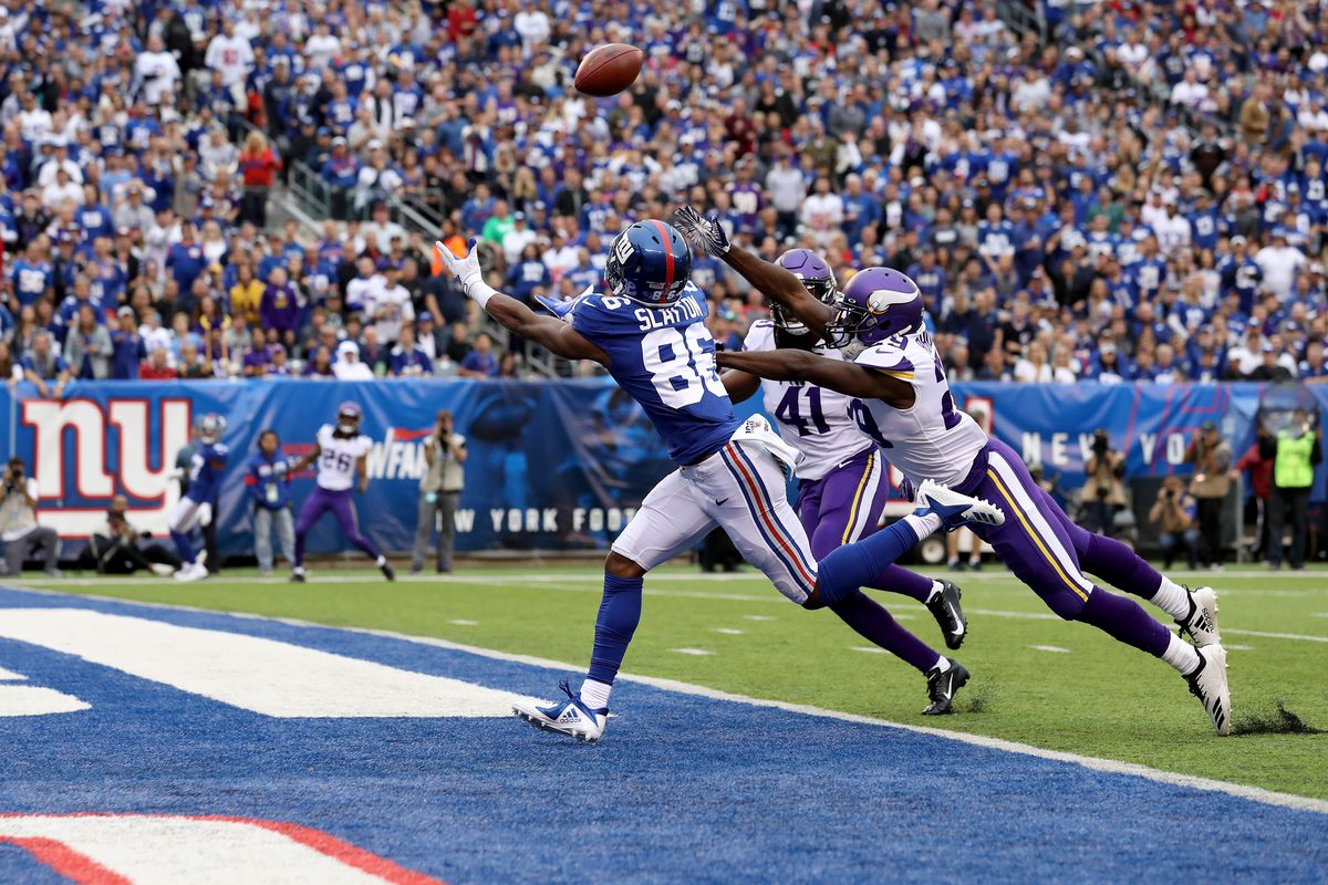 Darius Slayton of the New York Giants catches a 35 yard touchdown pass thrown by Daniel Jones against Xavier Rhodes and Anthony Harris of the Minnesota Vikings during the second quarter in the game at MetLife Stadium on October 06, 2019.