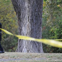 """A Minneapolis police officer cordons off an area outside the office of Accent Signage Systems in the Bryn Mawr neighborhood of Minneapolis, Thursday, Sept. 27, 2012. The shooter who opened fire inside a Minneapolis sign company was found dead from a self-inflicted gunshot wound Thursday and was among """"several"""" people killed in the incident, the city's deputy police chief said."""