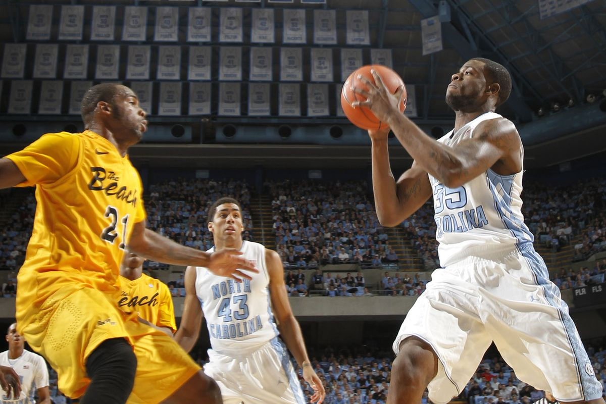 Dec, 10, 2011; Chapel Hill, NC, USA; North Carolina Tar Heels guard Reggie Bullock (35) with the ball as Long Beach State 49ers guard Larry Anderson (21) defends in the first half at the Dean E. Smith Center.
