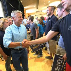 After the rally in the Student Union Building at the University of Utah in Salt Lake City, Libertarian presidential candidate Gov. Gary Johnson shakes hands as he and running mate Gov. Bill Weld exit on Saturday, Aug. 6, 2016.