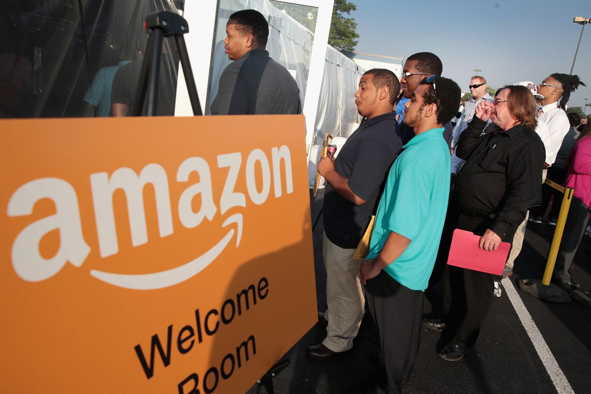 The amazon buffett jpmorgan chase health care announcement job seekers wait in line to apply for one of the 2500 jobs being offered at the amazon fulfillment center on august 2 2017 in romeoville illinois publicscrutiny Image collections
