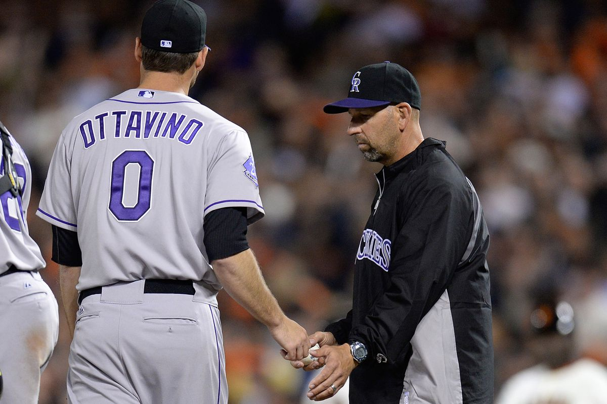 Rockies manager Walt Weiss takes the ball from relief pitcher Adam Ottavino, who gave up two runs on three hits in a third of an inning in the Rockies 9-6 loss to the Giants at AT&T Park.