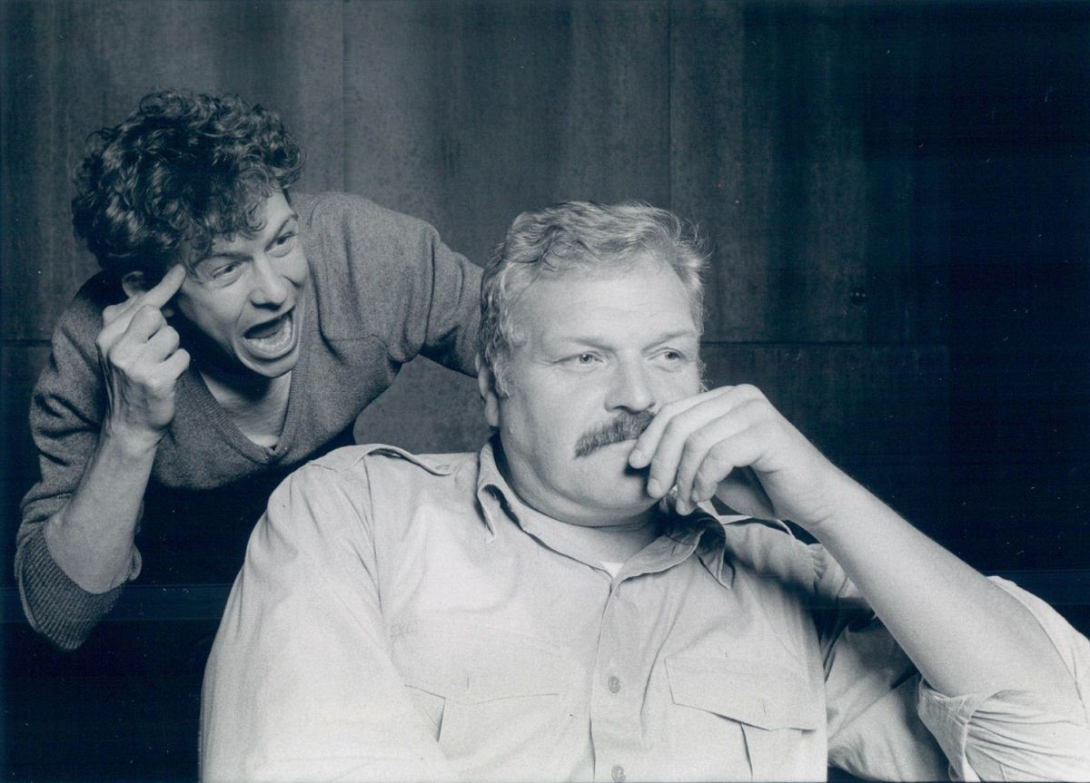 """James Lancaster (left) and Brian Dennehy in a scene from the Wisdom Bridge Theatre production of Ron Hutchinson's """"Rat in the Skull"""" in 1985."""
