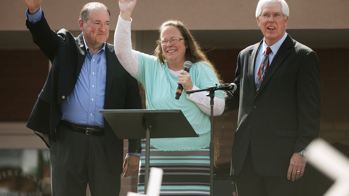 Liberty Counsel founder Mat Staver, right, stands with Mike Huckabee, left, and Kim Davis, center.