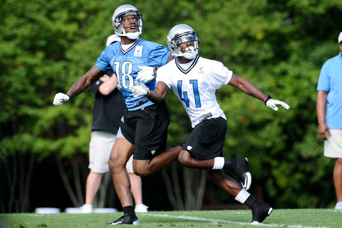 Detroit Lions wide receiver Dominique Curry (18) completes drills during training camp at the Detroit Lions training facility.