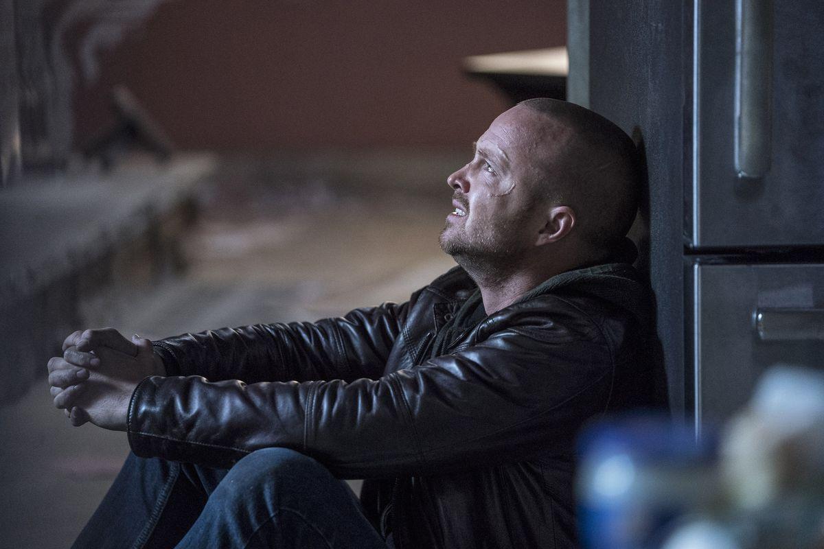 jesse pinkman is sad at a brick wall