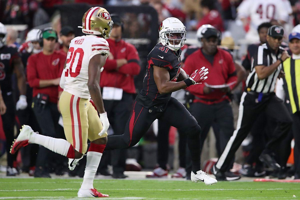 Running Back Kenyan Drake of the Arizona Cardinals rushes against cornerback Jimmie Ward of the San Francisco 49ers at State Farm Stadium on October 31, 2019 in Glendale, Arizona.