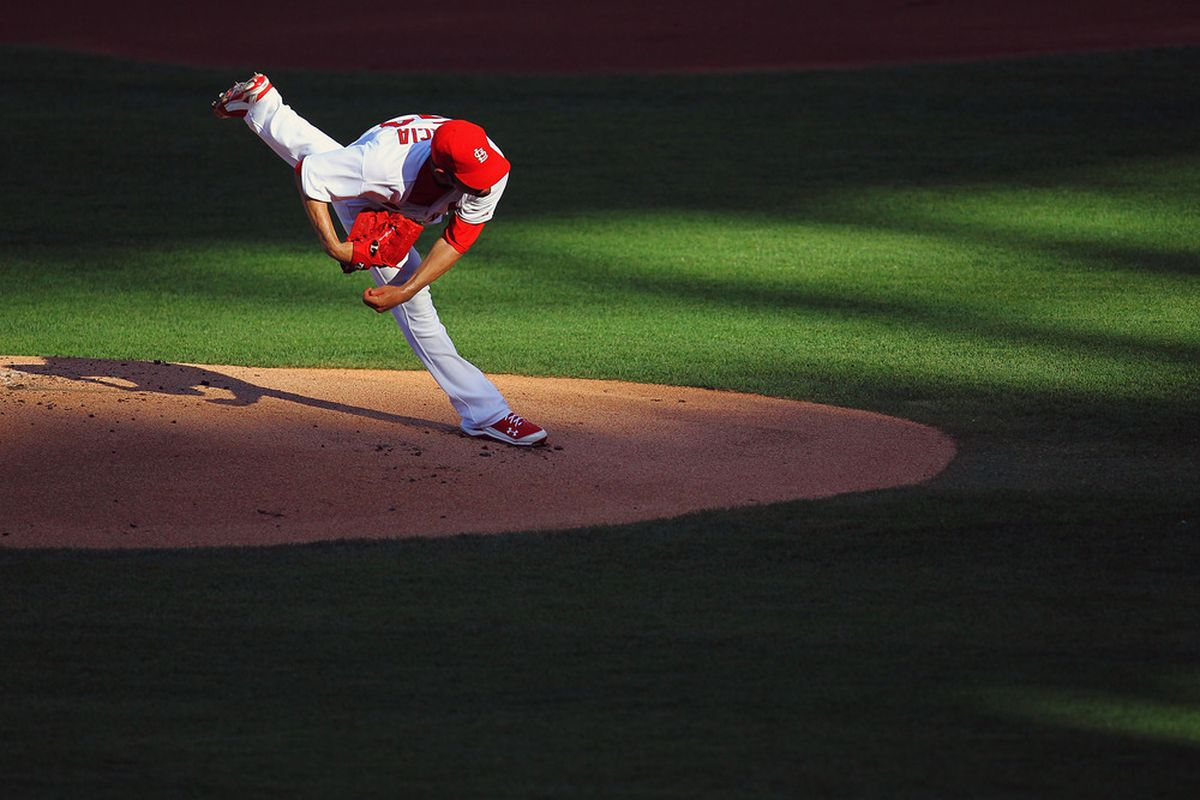 ST. LOUIS, MO - JULY 5: Starter Jaime Garcia #54 of the St. Louis Cardinals pitches against the Cincinnati Reds at Busch Stadium on July 5, 2011 in St. Louis, Missouri.  (Photo by Dilip Vishwanat/Getty Images)