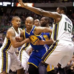 Jazz guard Earl Watson, left, and forward Derrick Favors squeeze Warriors guard Jarrett Jack (2) during the first half of the NBA basketball game between the Utah Jazz and the Golden State Warriors at Energy Solutions Arena, Wednesday, Dec. 26, 2012.