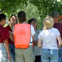 Volunteers wait outside the Federal Heights LDS wardhouse,the headquarters for the search for kidnapped Elizabeth Smart.