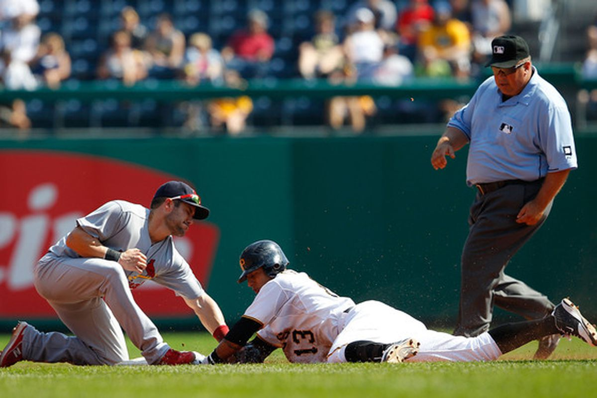 PITTSBURGH - SEPTEMBER 23: Skip Schumaker #55 of the St Louis Cardinals tags out Ronny Cedeno #13 of the Pittsburgh Pirates during the game on September 23 2010 at PNC Park in Pittsburgh Pennsylvania.  (Photo by Jared Wickerham/Getty Images)